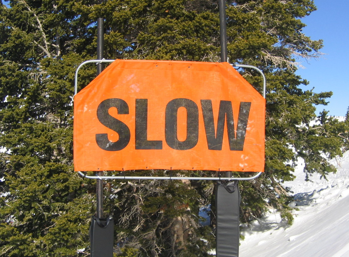 Ski Trail Sign for Slowing Down